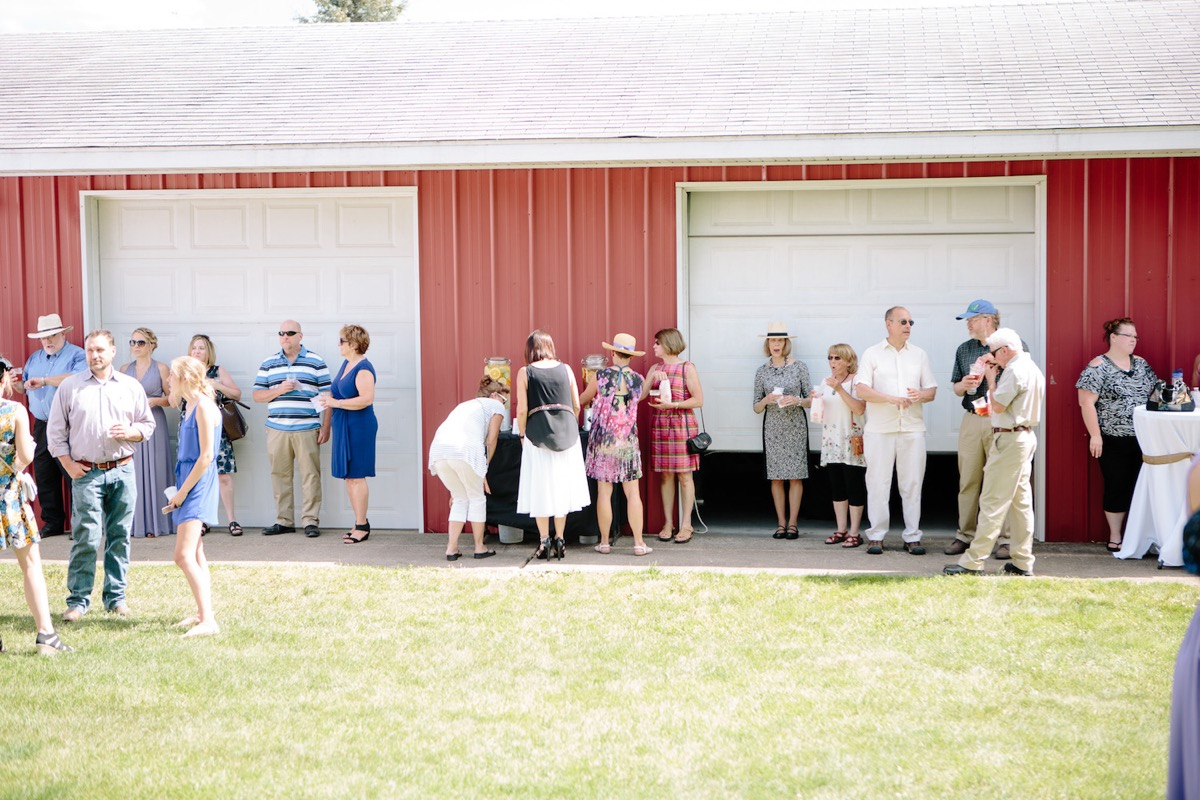 wedding_guests_side_of_red_barn_cocktail_hour.jpg
