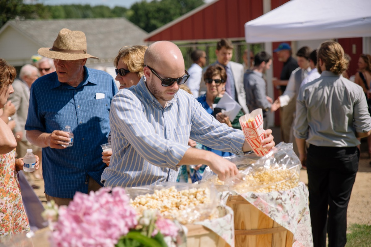 wedding_guests_taking_popcorn_from_barrels_cocktail_hour.jpg
