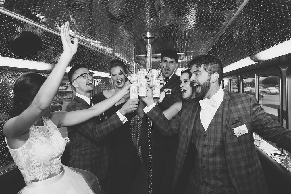 wedding_party_bus_brides_arms_in_air_minneapolis.jpg