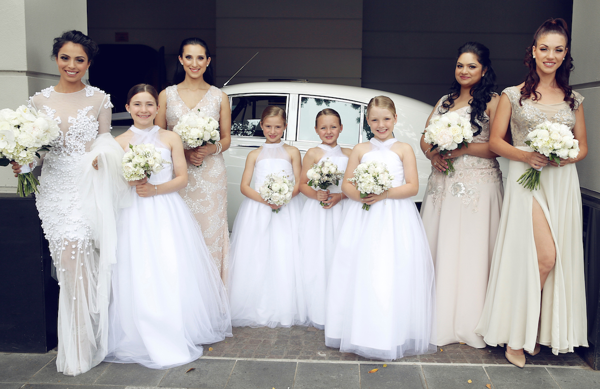 wedding_party_girls_in_front_of_car.jpg
