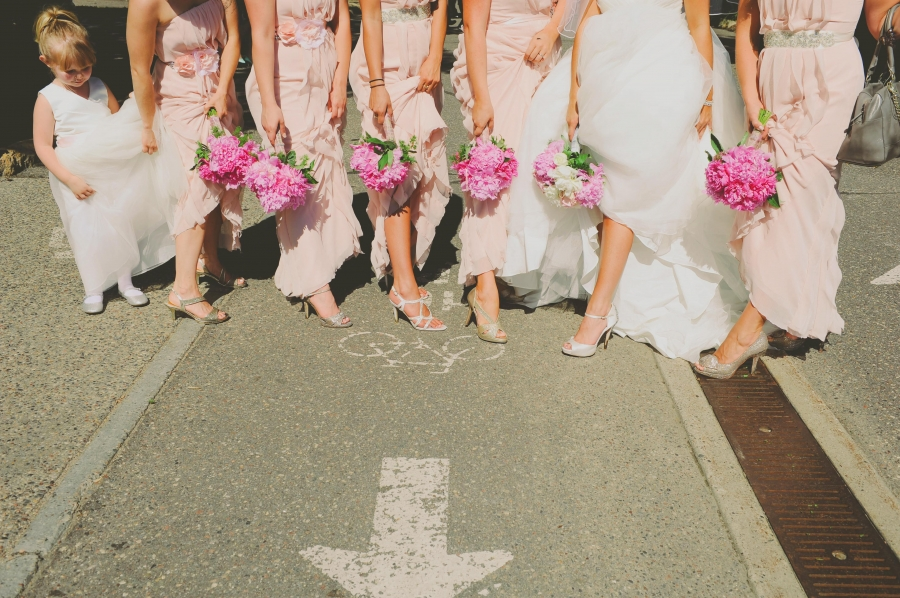 wedding_party_hiking_up_dresses_showing_white_shoes.jpg