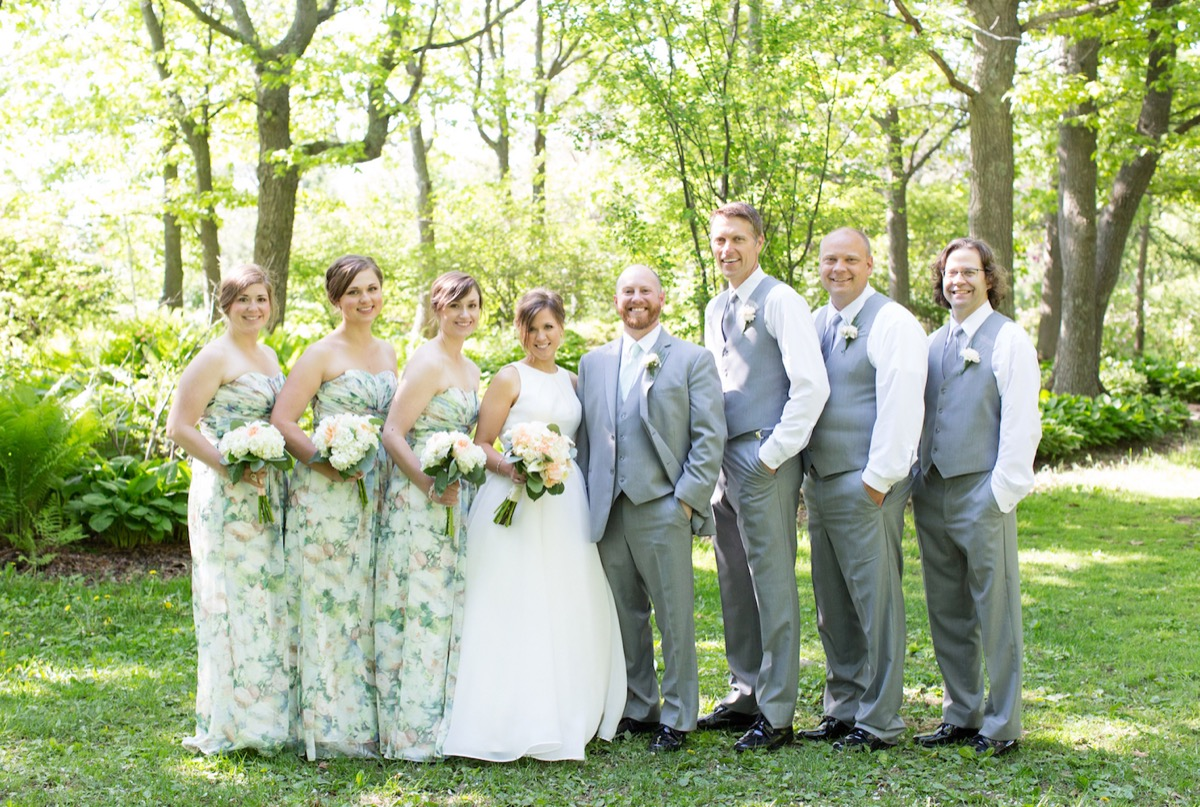 wedding_party_light_gray_tuxes_green_patterned_dresses.jpg