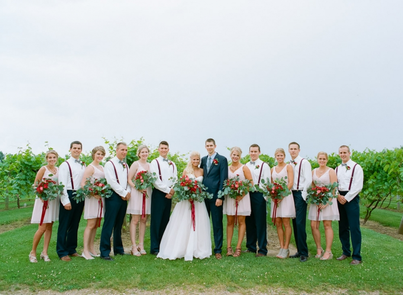 wedding_party_standing_in_winery_rainy_day.jpg