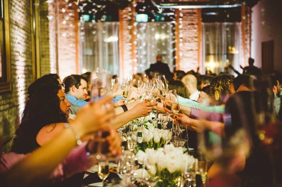 wedding_party_toasting_warehouse_reception.jpg