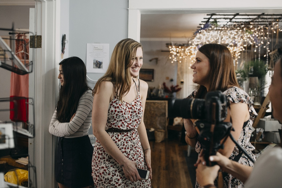 wedding_planner_and_mn_photographer_laughing_behind_scenes.jpg