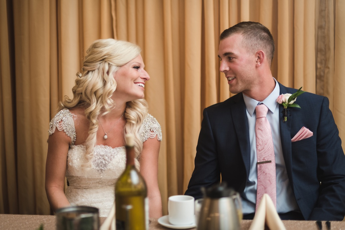 wedding_reception_duluth_minnesota_newlyweds_smiling.jpg