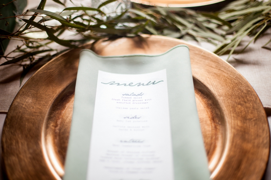 wedding_reception_green_white_menu_on_gold_serving_plate.jpg