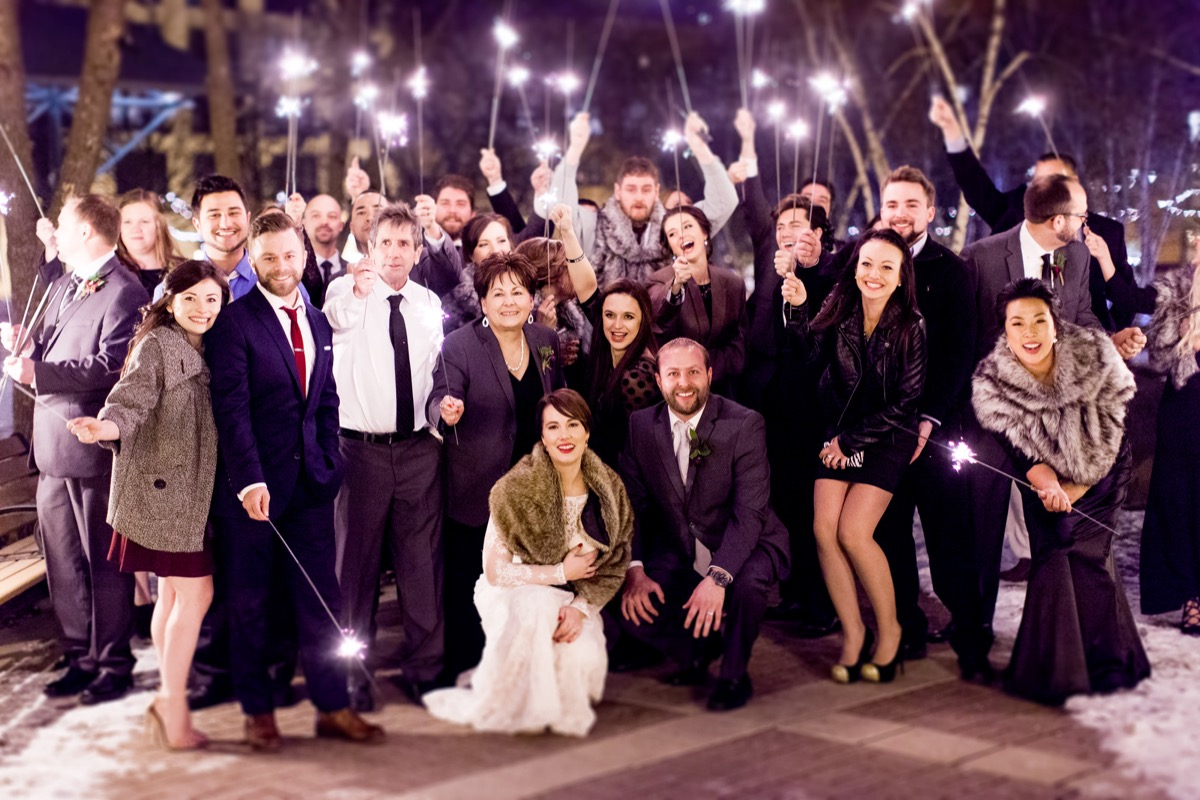 wedding_smiling_group_photo_sparklers_night_time_cold_mn.jpg