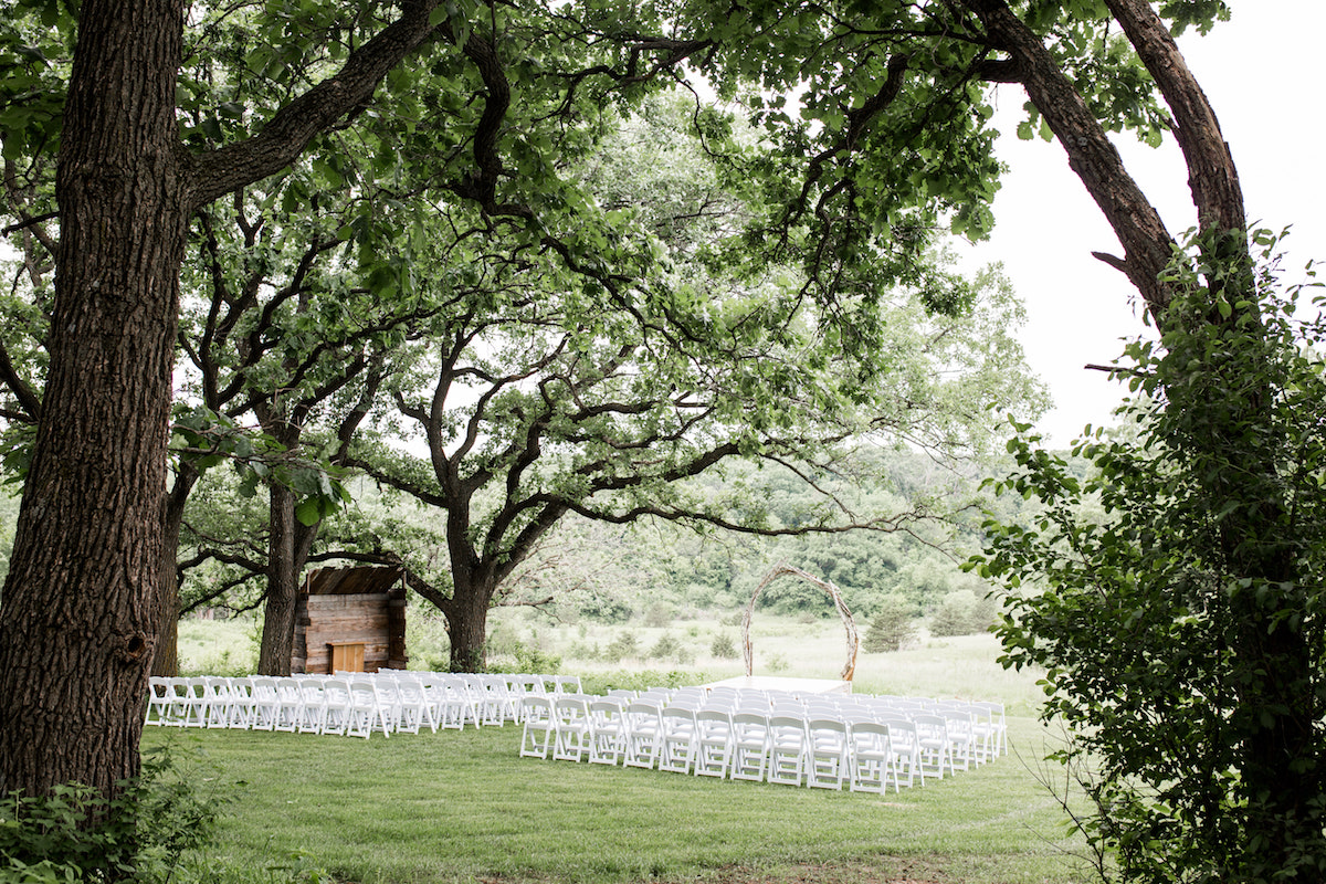 wedding_venue_outdoor_large_sprawling_trees_white_chairs.jpg