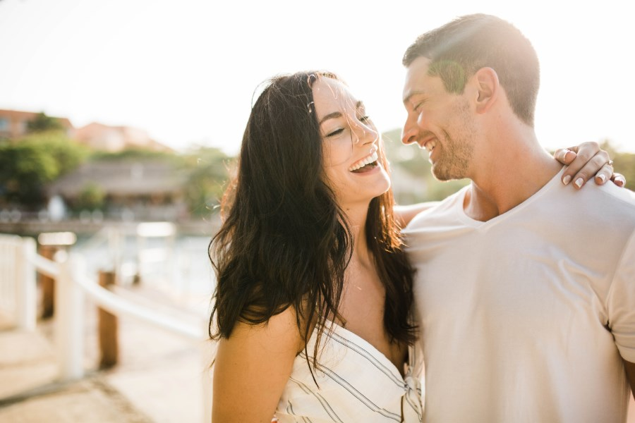 white_blue_striped_dress_couple_laughing_mexico_engagement.jpg