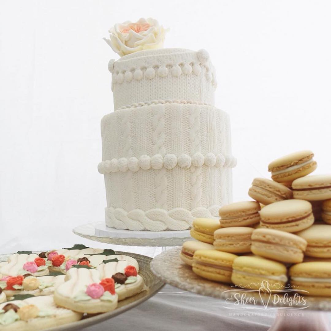white_cake_with_macaroons_and_desserts.jpg