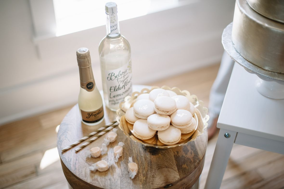 white_macaroons_on_wooden_table_gold_platter.jpg