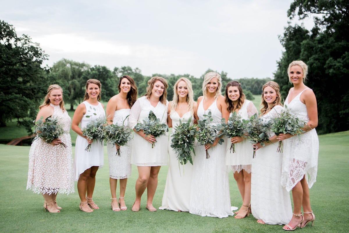 white_mismatched_bridesmaid_dresses_simple_greenery_bouquets.jpg
