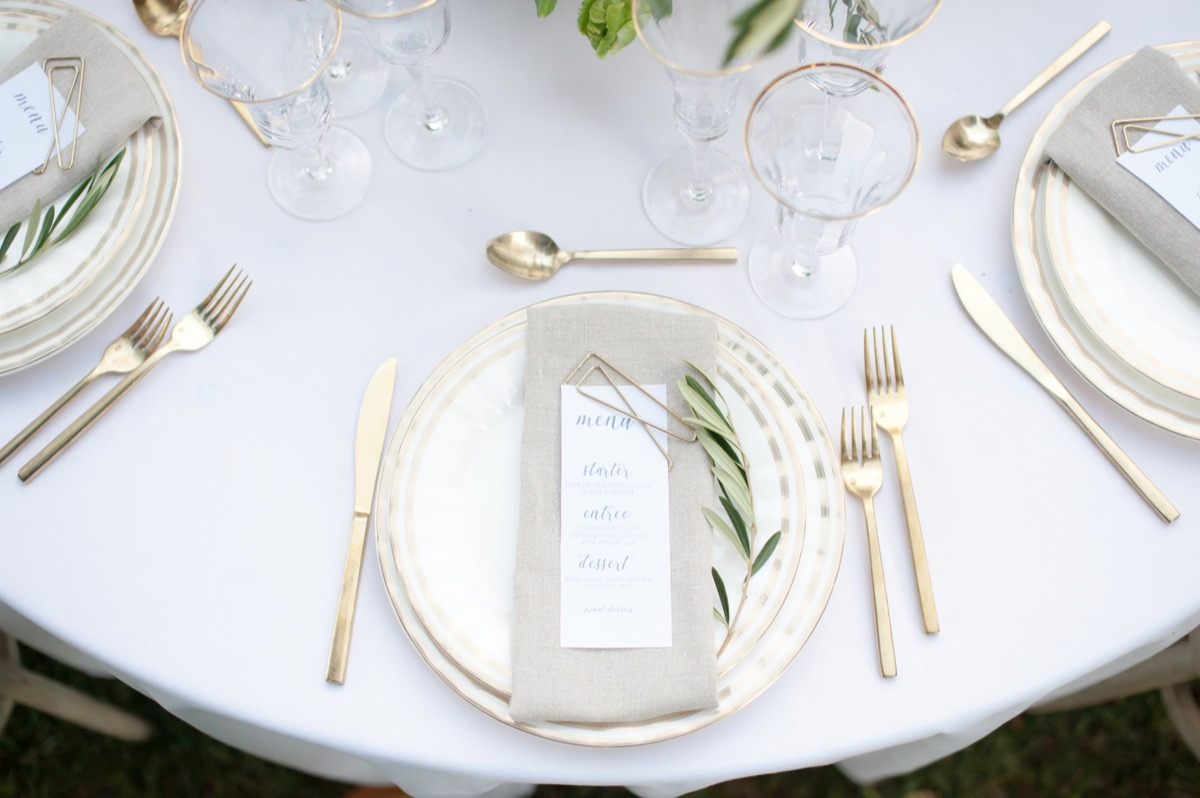 white_table_cloth_gold_silverware_reception_table_settings.jpg