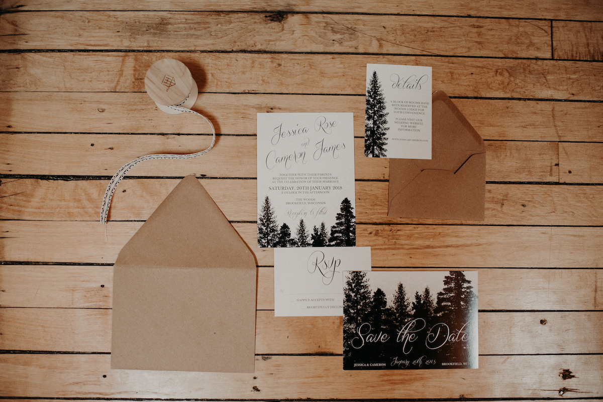 winter_forest_wedding_stationary_on_wood_floor.jpg