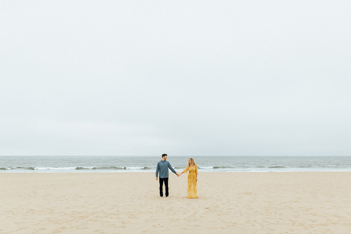 woman_and_fiance_holding_hands_side_by_side_california_beach.JPG
