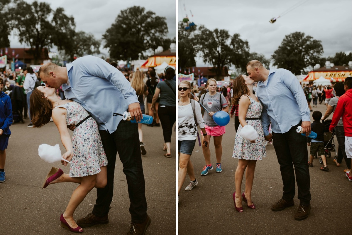 woman_holding_cotton_candy_engagement_couple_kissing_fair.jpg