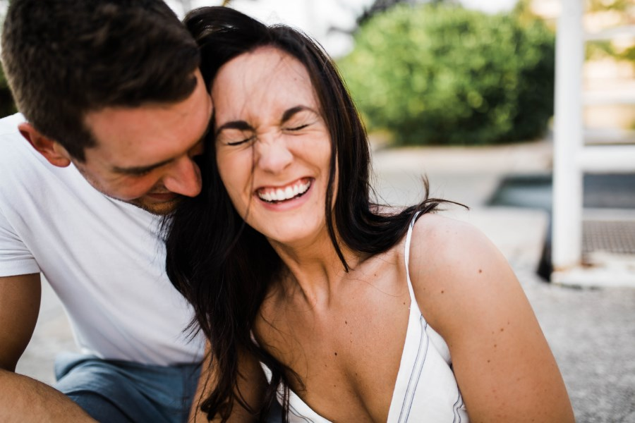 woman_laughing_leaning_towards_fiance_mexico.jpg