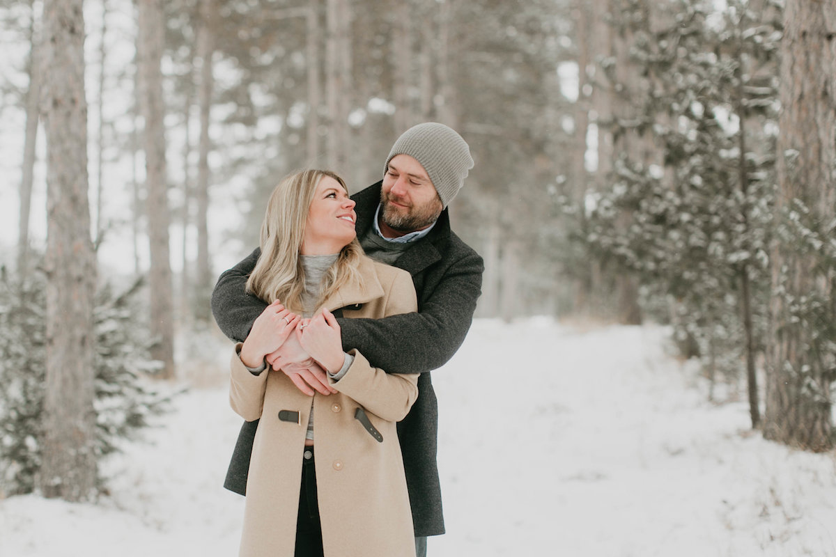 woman_smiling_at_fiance_in_winter_forest.jpg