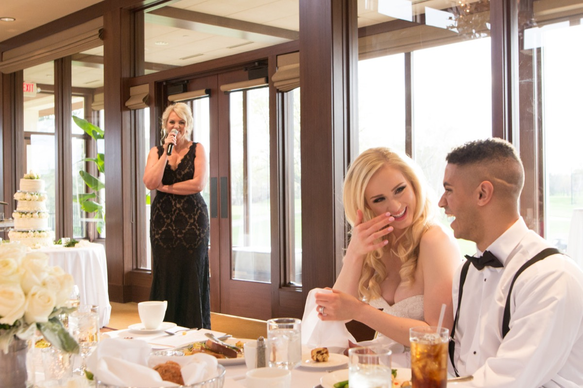 woman_speaking_at_wedding_reception_bride_laughing.jpg
