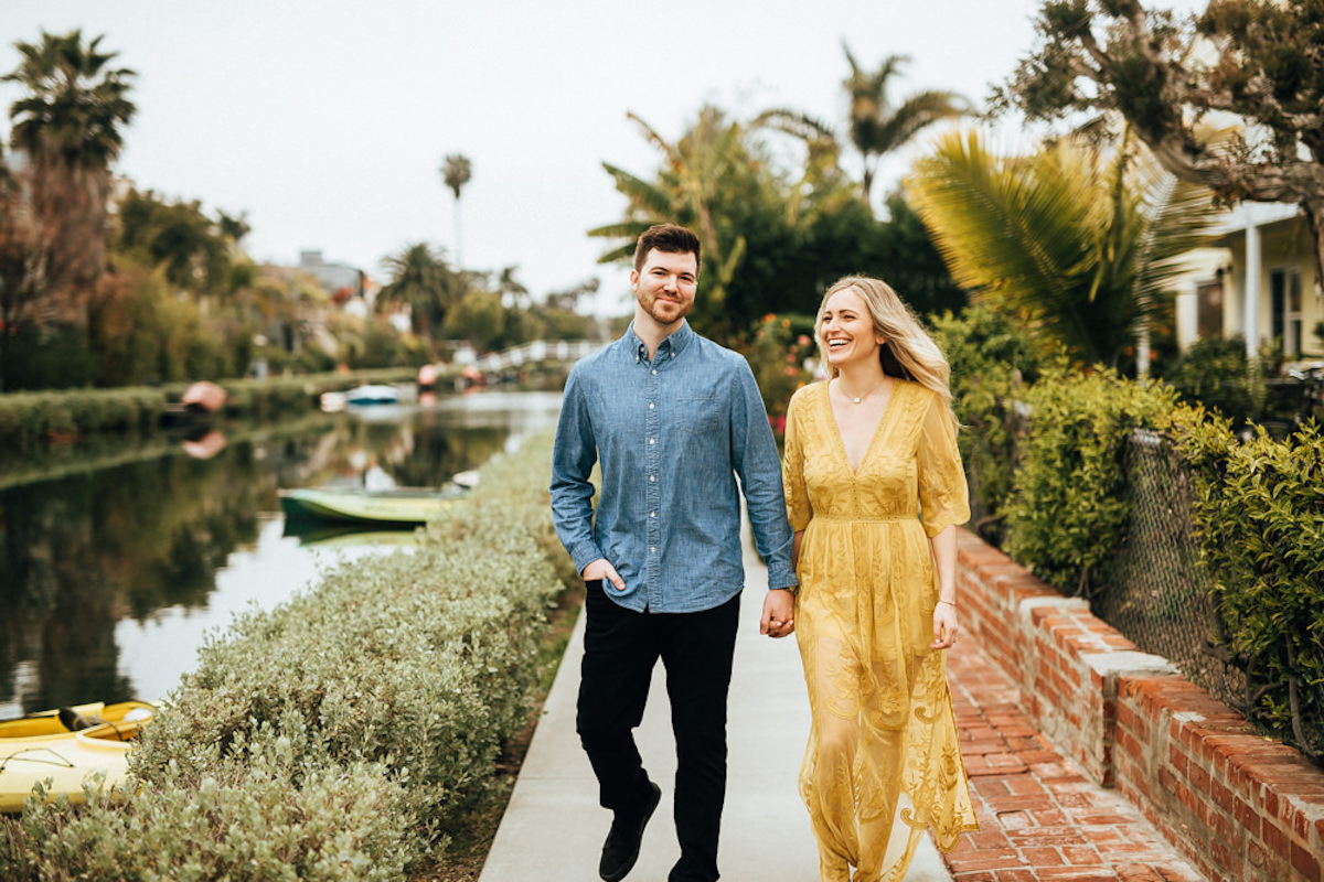 woman_yellow_dress_laughing_with_fiance_marina_del_rey_water_palm_trees.JPG