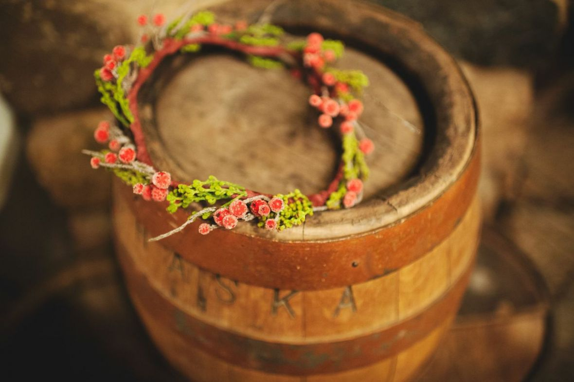 wrapped_in_love_red_christmas_flower_crown_on_barrel.jpg